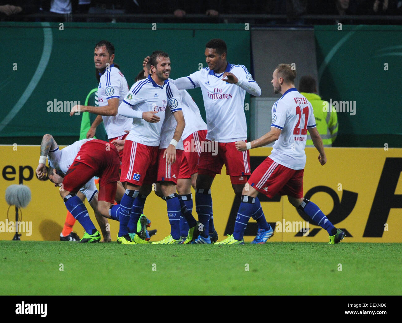 Hamburg, Germany. 24th Sep, 2013. Hamburg's players including Heiko Westermann (2-L), Rafael van der Vaart (3-L), Maximilian Beister (R) celebrate with Pierre-Michael Lasogga after his 1-0 goal during the DFB Cup second round match between Hamburger SV and SpVgg Greuther Fuerth at Imtech Arena in Hamburg, Germany, 24 September 2013. Photo: ANGELIKA WARMUTH/dpa/Alamy Live News - Stock Image