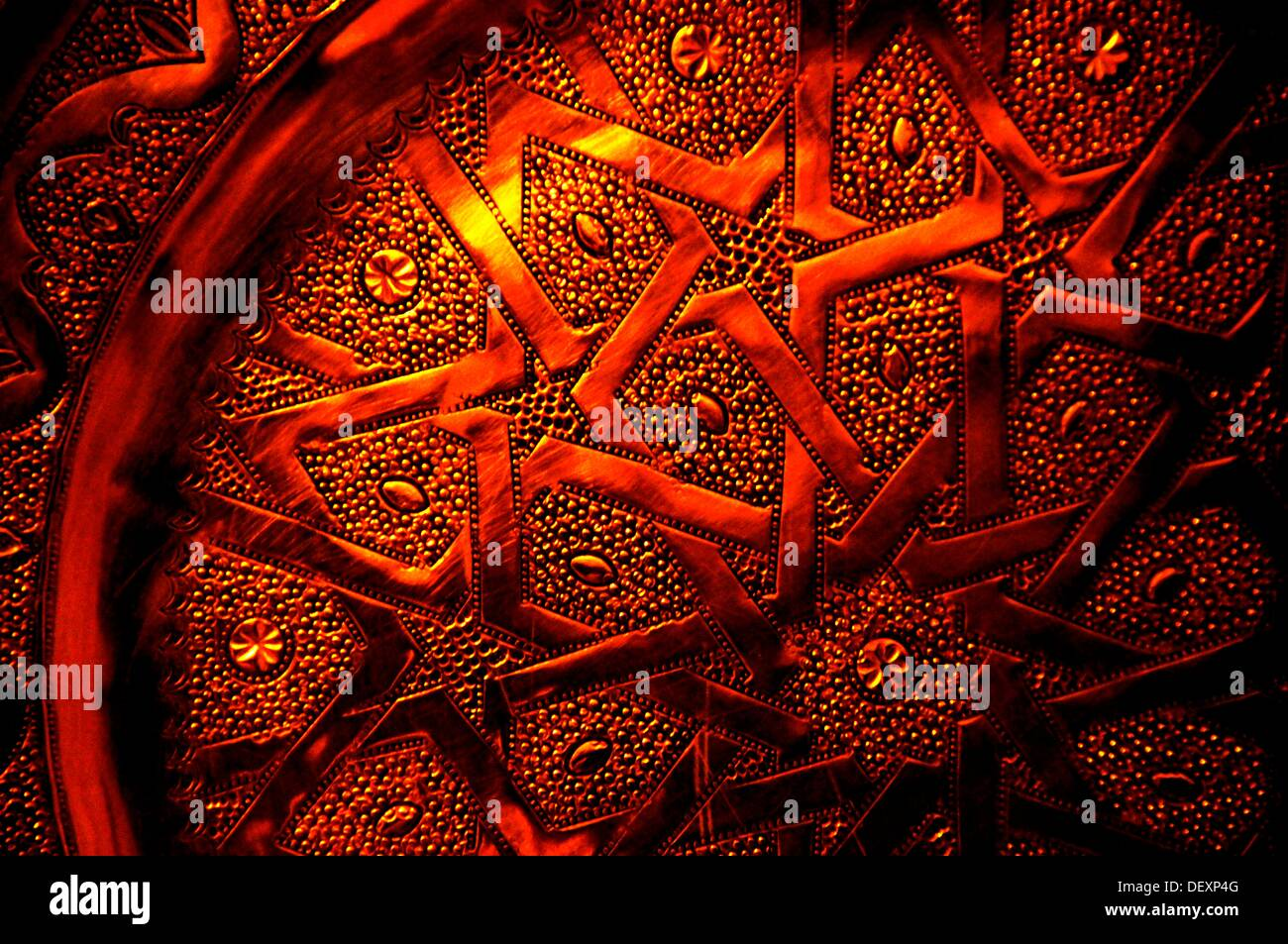 Detail of a hand made copper plate, Morocco - Stock Image