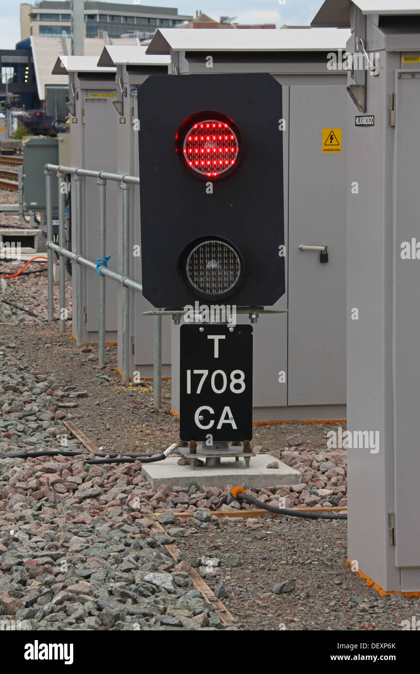 Co-acting Signal 'T 1708 CA' at exit from sidings with signal showing a red 'Stop' aspect. - Stock Image