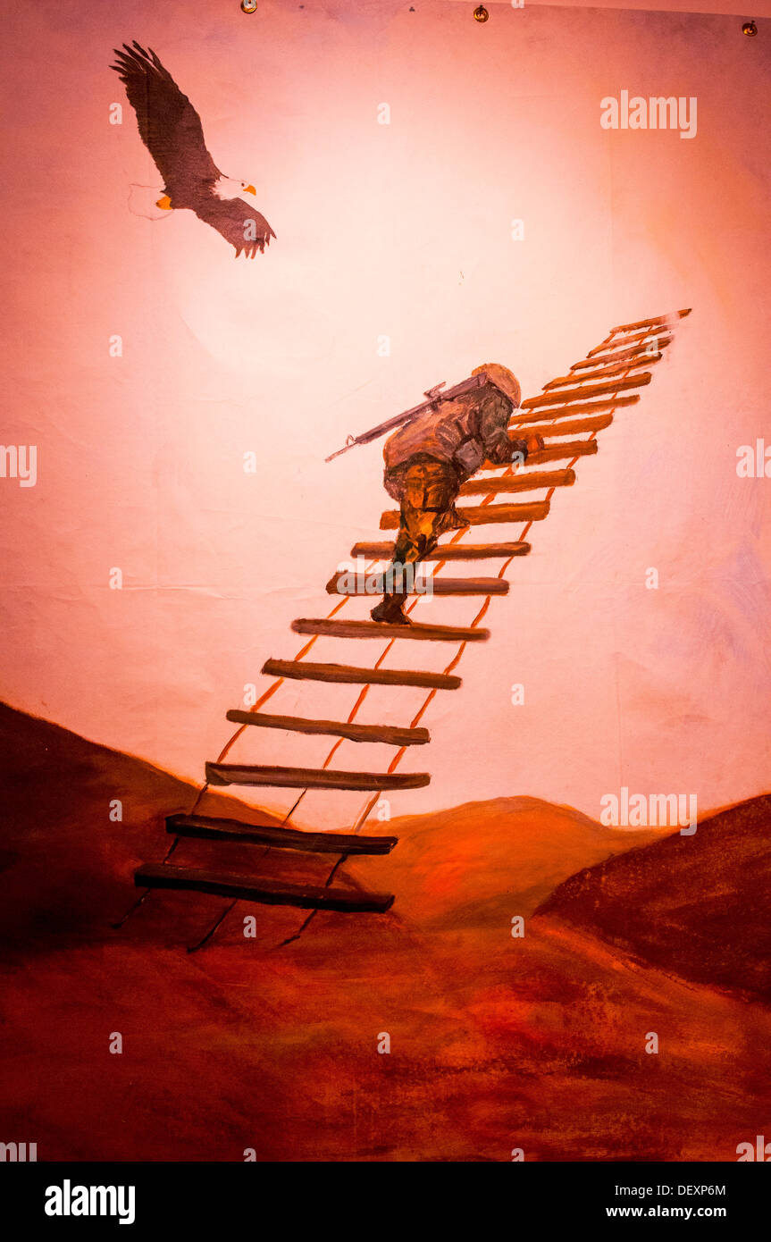 SAN DIEGO, Calif. -- A service member makes a solitary climb in one of the paintings featured in the Combat Arts exhibit in the - Stock Image