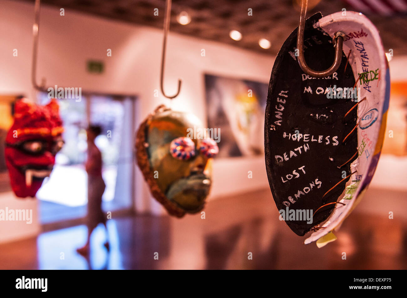 SAN DIEGO, Calif. -- Sculptural masks created by Iraq and Afghanistan war veterans hang in the Southwestern University art gallery, where they are featured in the Combat Arts exhibit Sept. 14, 2013. The art pieces in the exhibit were all created by Iraq a - Stock Image