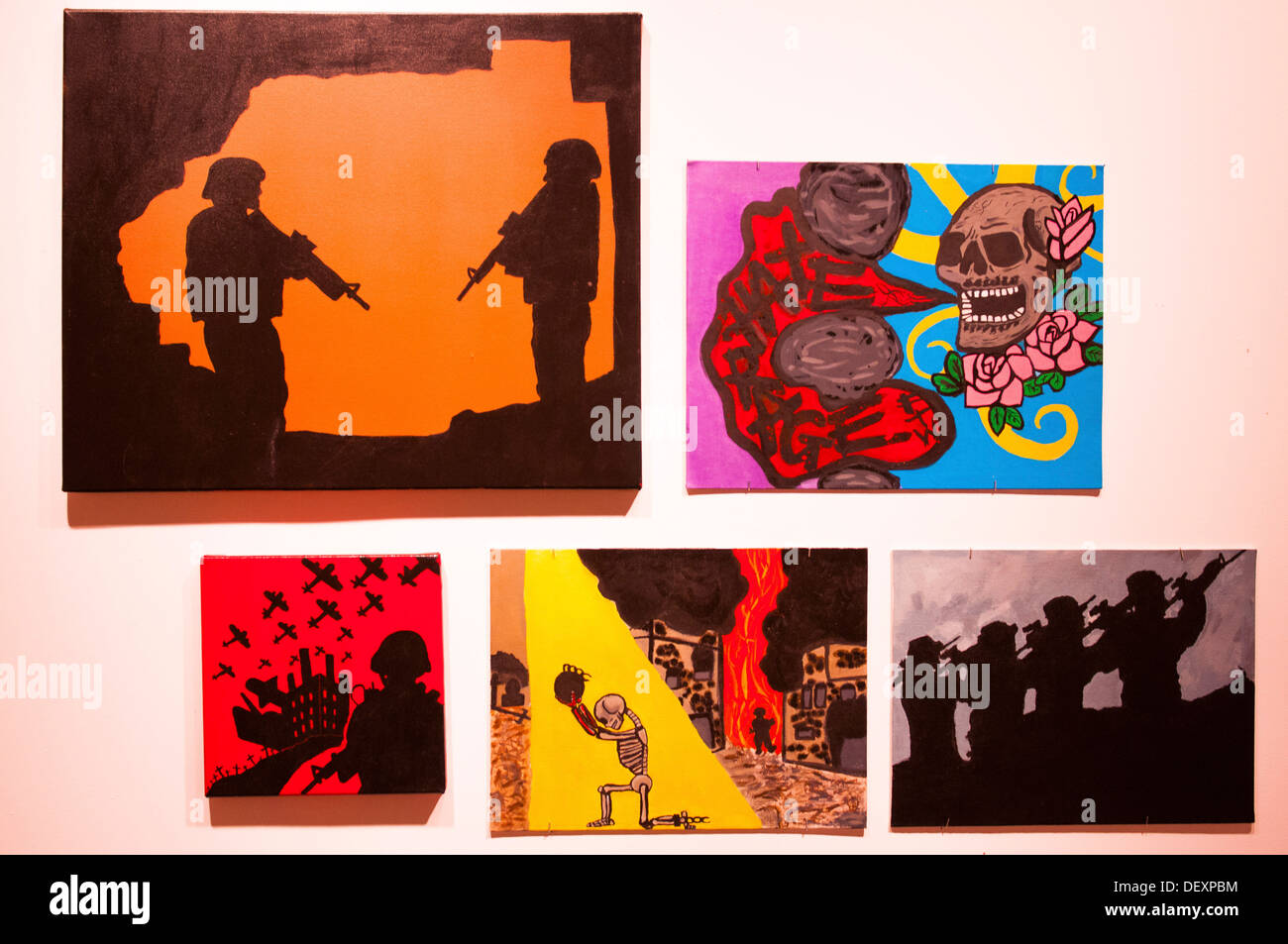 Paintings created by Iraq and Afghanistan war veterans who suffer from post-traumatic stress disorder hang in the - Stock Image
