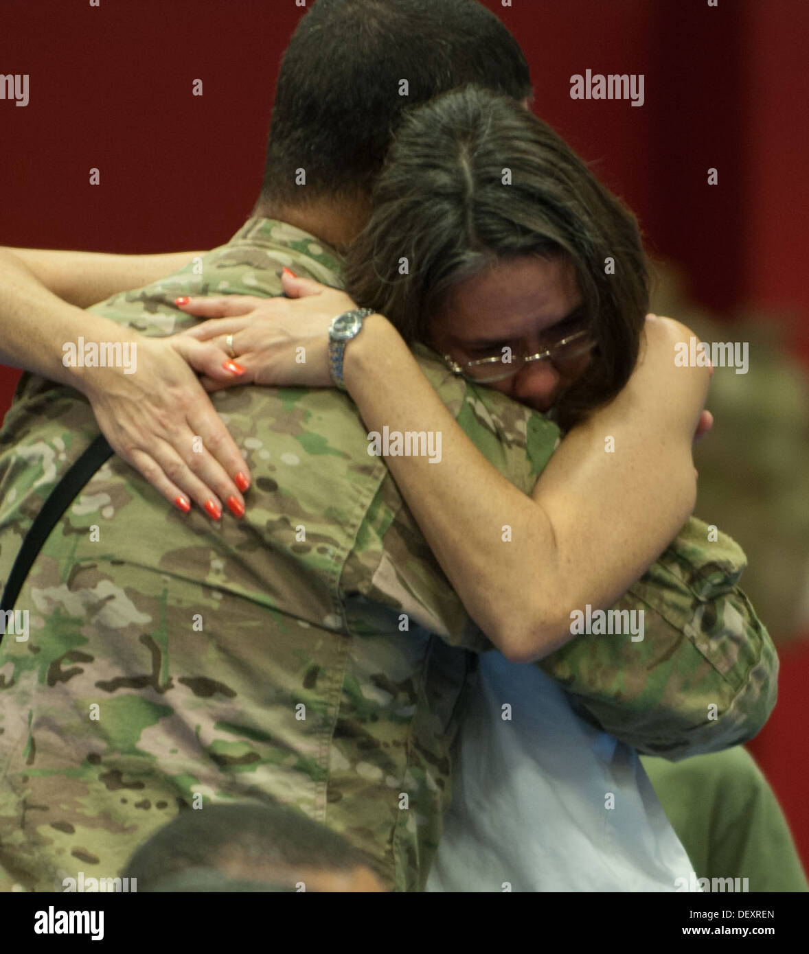A couple shares an embrace following a final call to 163rd Military Intelligence Battalion soldiers deploying to Afghanistan. - Stock Image