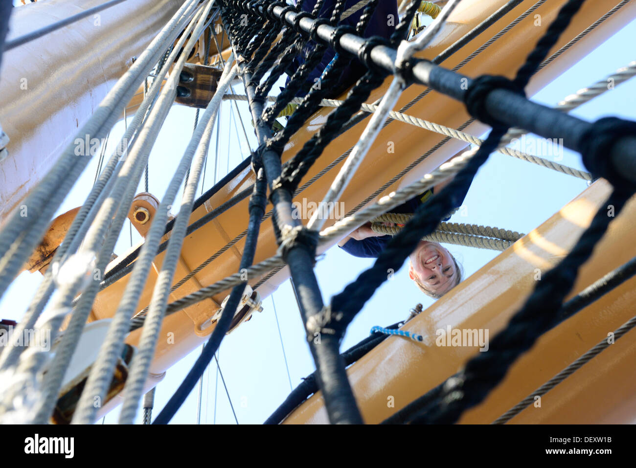 Petty Officer 3rd Class Shelbie Smart, a boatswain's mate aboard the Coast Guard Barque Eagle, prepares to climb Stock Photo