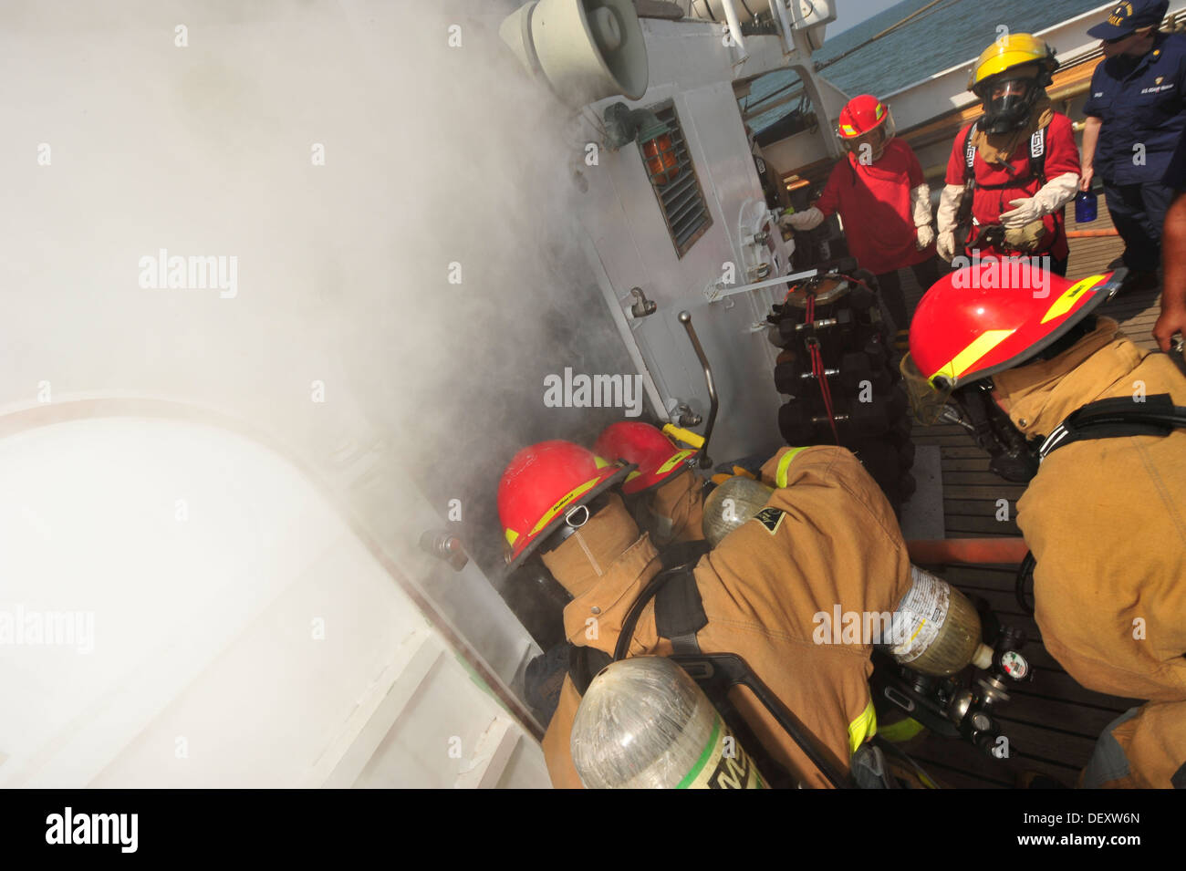 Officer candidates engage a simulated fire in the laundry room aboard the Coast Guard Barque Eagle on Thursday, Sept. 12, 2013. - Stock Image