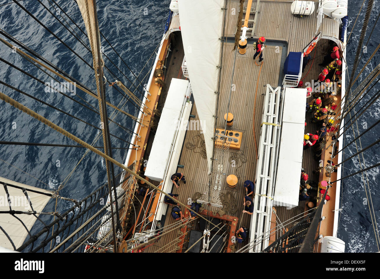 Officer candidates conduct fire drills and line handling aboard the Coast Guard Barque Eagle on Monday, Sept. 16, 2013. A ship's crew must be well trained in damage control and seamanship. - Stock Image