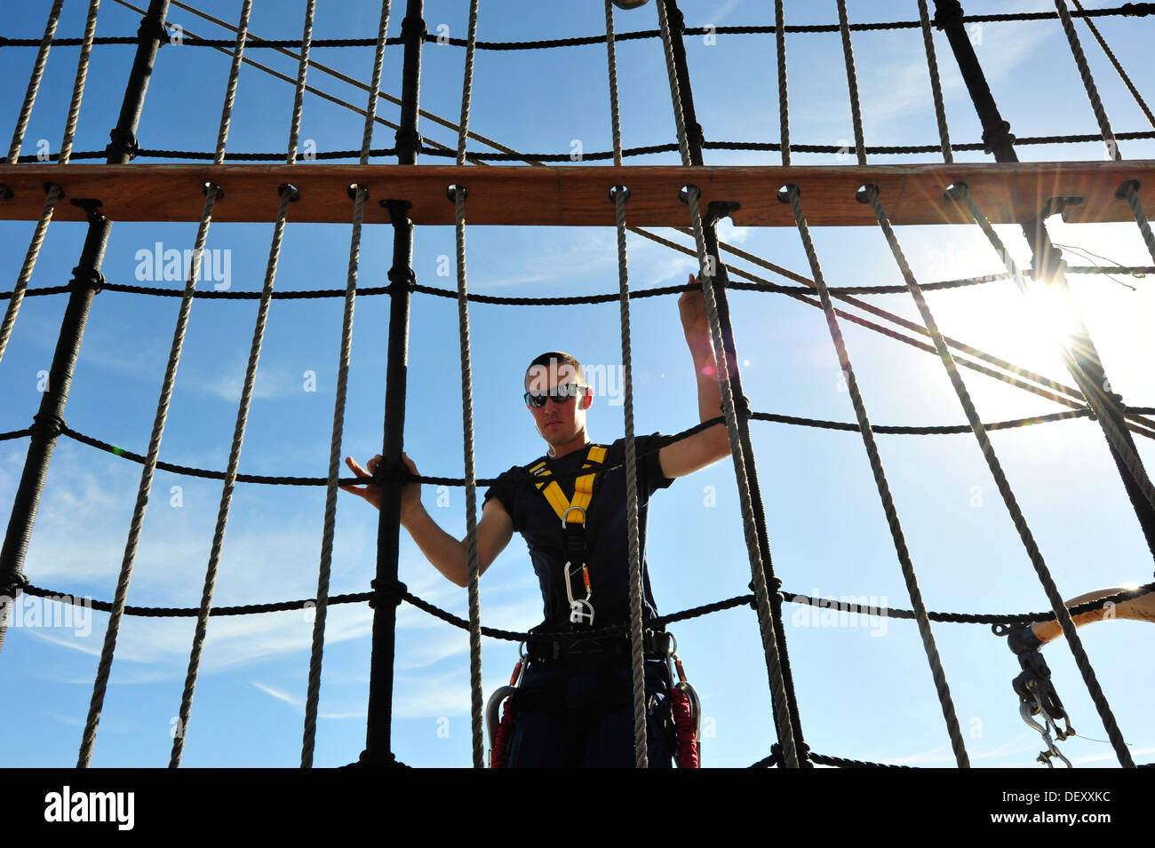 Coast Guard Barque Eagle crew member Seaman Joel Sprowls climbs down the rigging after furling sails aboard EAGLE on Wednesday, - Stock Image