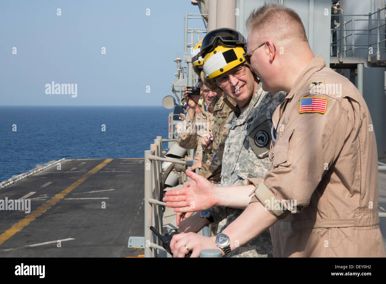 Army Maj. Gen. Terry Ferrell, commander, Combined Joint Task Force Horn of Africa, receives a flight deck operations brief from - Stock Image