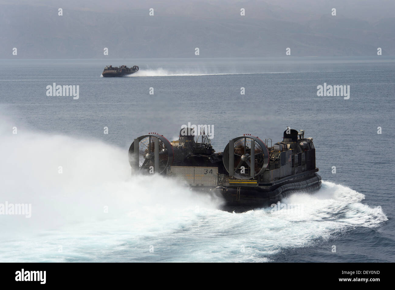Landing craft air cushions (LCAC) from Assault Craft Unit (ACU) Four conduct operations while attached to the amphibious assaul - Stock Image