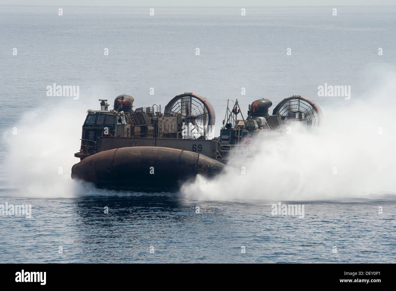 landing craft air cushion (LCAC) from Assault Craft Unit (ACU) Four conducts operations while attached to the amphibious assaul - Stock Image