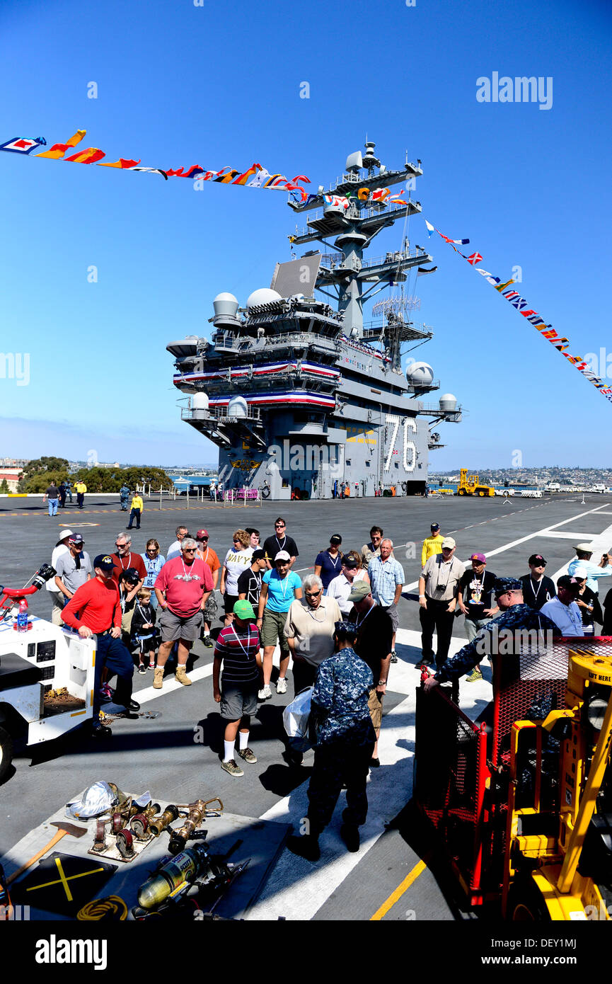"""Guests observe a presentation by the aircraft carrier USS Ronald Reagan's (CVN 76) crash and salvage team during a tour on the ship's flight deck. Ronald Reagan, """"America's Flagship,"""" is participating in the annual Coronado Speed Festival. This event was - Stock Image"""