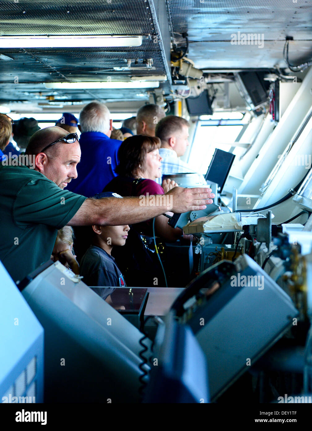 """Guests tour the navigation bridge aboard the aircraft carrier USS Ronald Reagan (CVN 76). Ronald Reagan, """"America's Flagship,"""" is participating in the annual Coronado Speed Festival. This event was created in 1997, to honor the military while enjoying a r - Stock Image"""