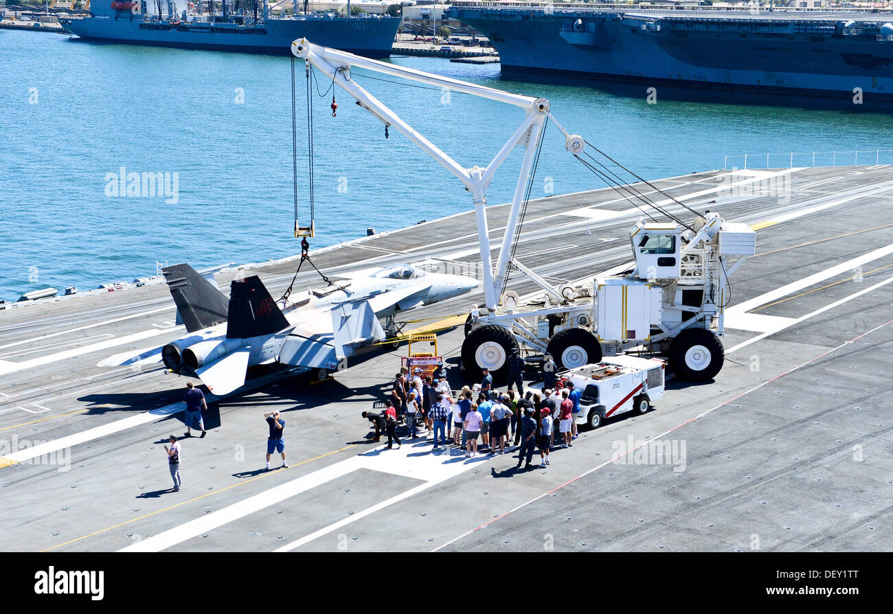 "Guests from the annual Coronado Speed Festival observe a presentation by the aircraft carrier USS Ronald Reagan's (CVN 76) crash and salvage team during a tour on the ship's flight deck. Ronald Reagan, ""America's Flagship,"" is participating in the annual - Stock Image"