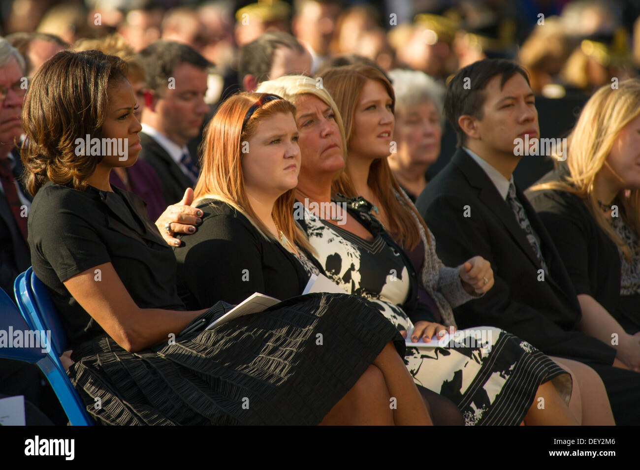 Friends and family of those killed at a Navy Yard shooting look on during a memorial for those killed during a shooting Stock Photo