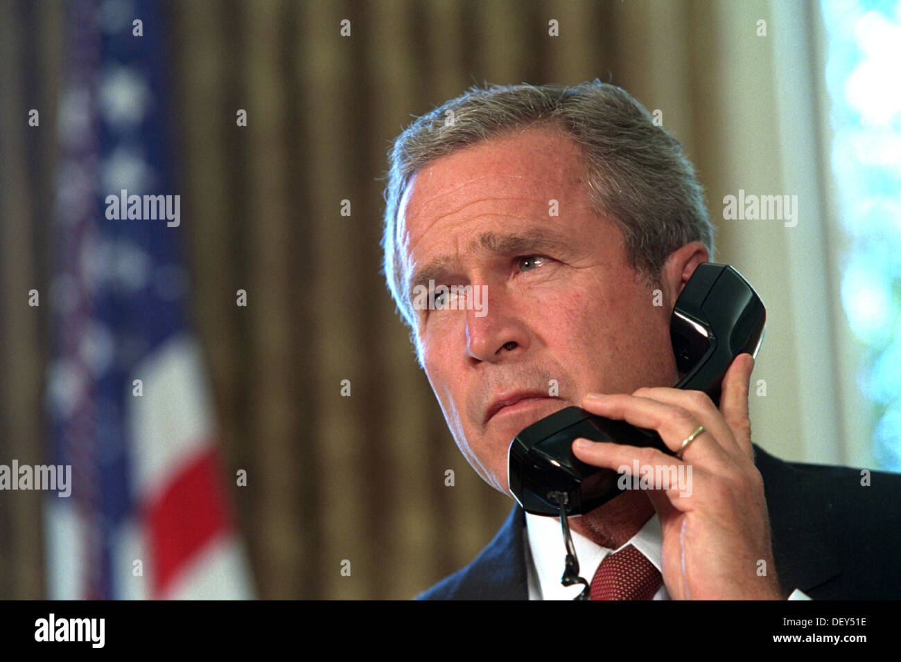 US President George W. Bush talks by telephone with New York Gov. George Pataki and New York City Mayor Rudolph Stock Photo