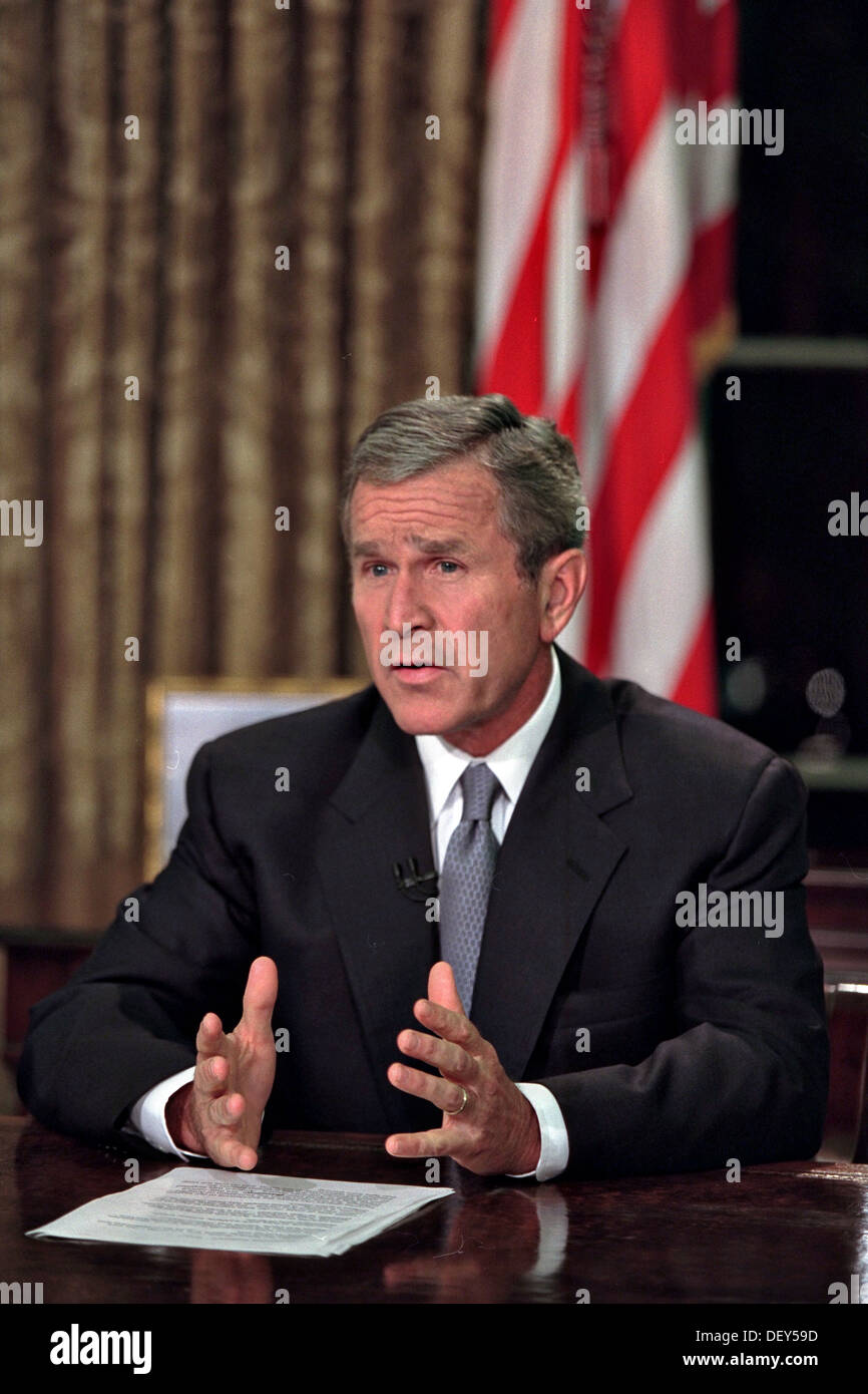 US President George W. Bush delivers his televised Address to the Nation following the terrorist attacks from the Oval Office of the White House September 11, 2001 in Washington, DC. - Stock Image