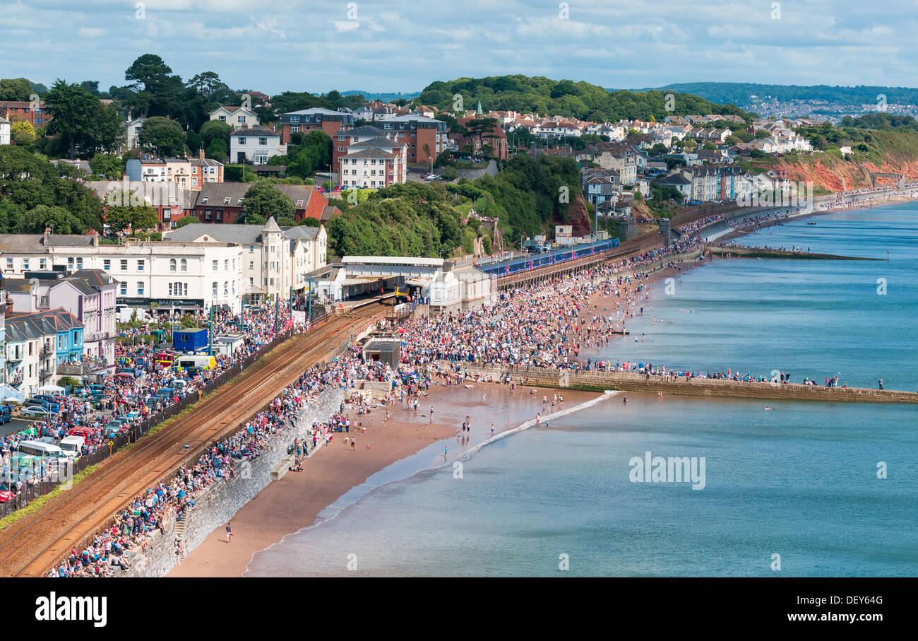 Dawlish,Devon,England. August 24th 2013. Dawlish railway station, town centre and crowded beach during Dawlish Air Show 2013. - Stock Image