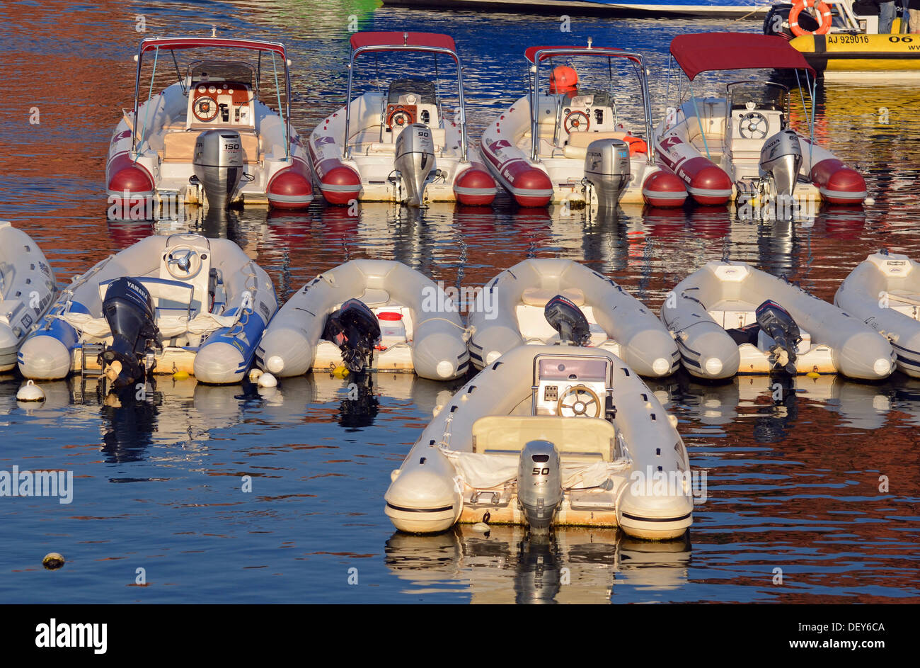 Inflatable boats with outboard motors in the harbor of Porto, Guaita, Porto, Corsica, France - Stock Image