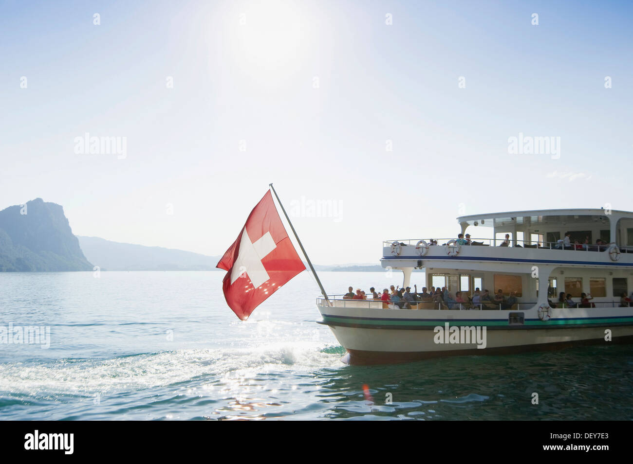 Passenger boat, liner, with the Swiss flag, Vitznau, Lake Lucerne, Canton of Lucerne, Switzerland, Europe - Stock Image
