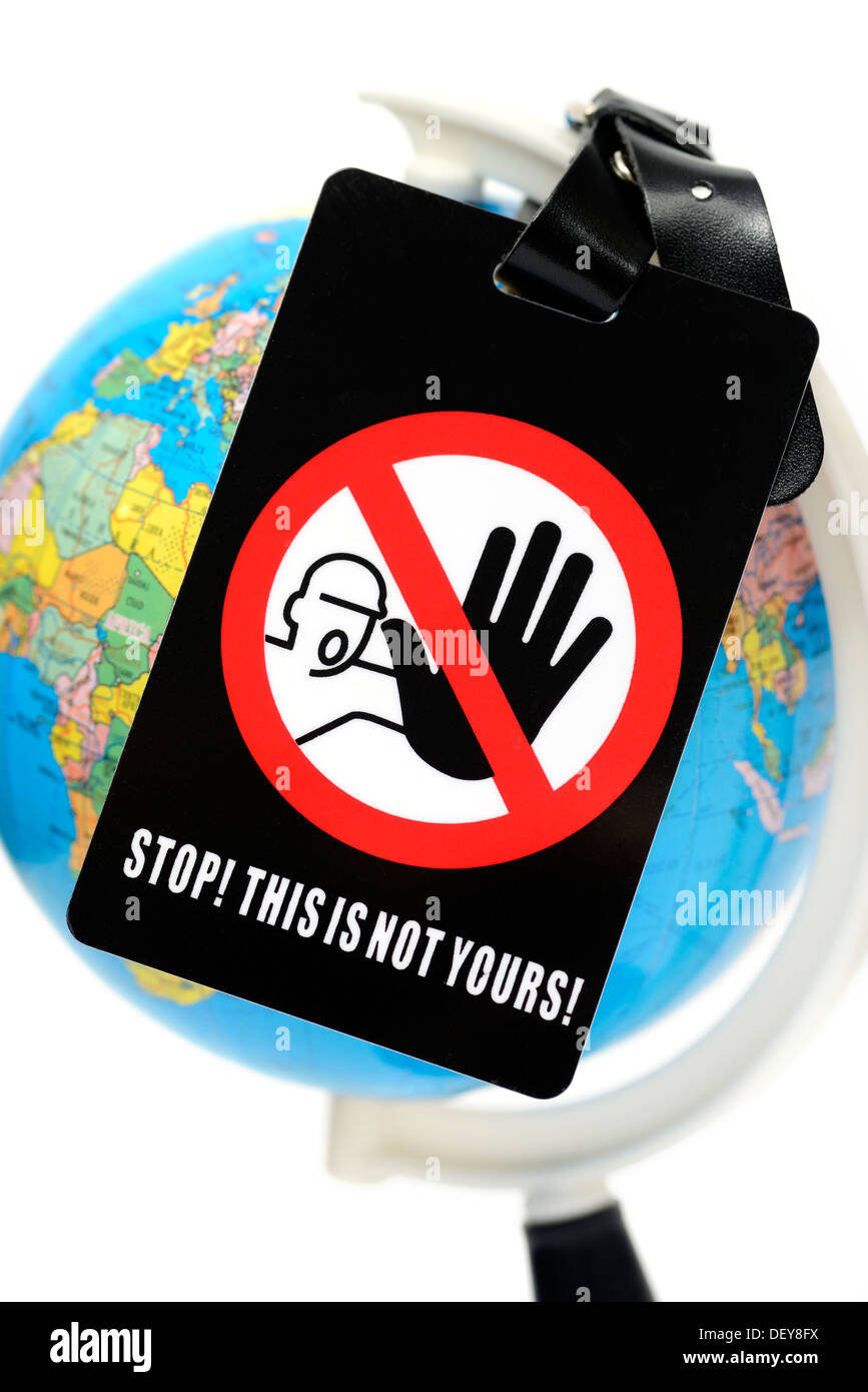Globe with sign Stop, this is yours!, Globus mit Schild Stop, this is not yours! - Stock Image