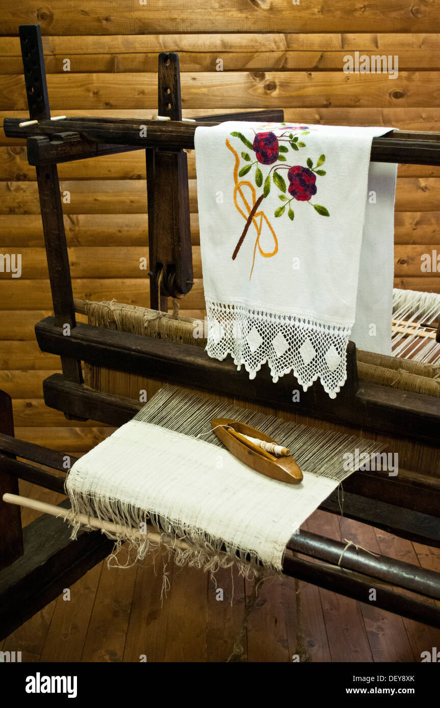 Old weaving loom with an example of regional textiles displayed in the Ethnographic museum, Museum of Gacka, Otocac, Croatia - Stock Image