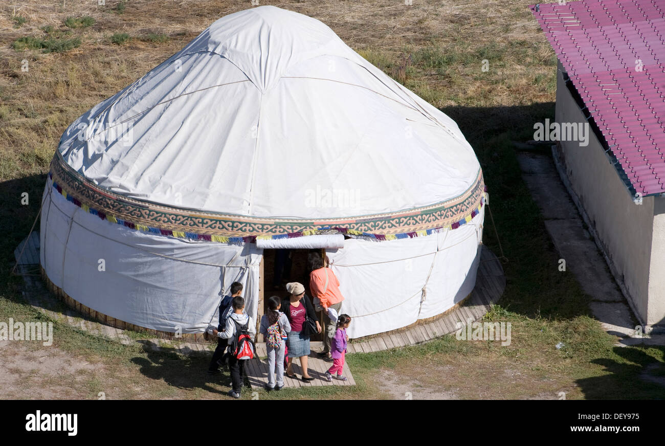 A yurt is used for the sale of handicrafts near an adjacent museum near Tokmok, Kyrgyzstan, Sept. 22, 2013. The yurt is a mobile structure used by the nomadic tribes of Central Asia for thousands of years. - Stock Image