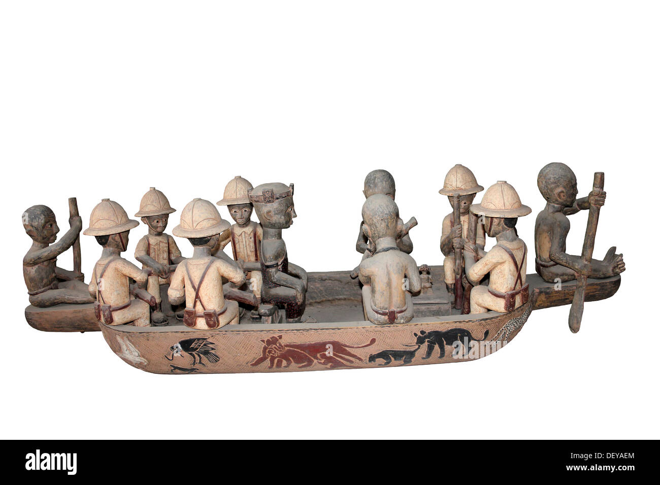 Wood carving depicting Europeans in Africa being paddled in a boat by natives. Possibly by the Yoruba people, Nigeria - Stock Image