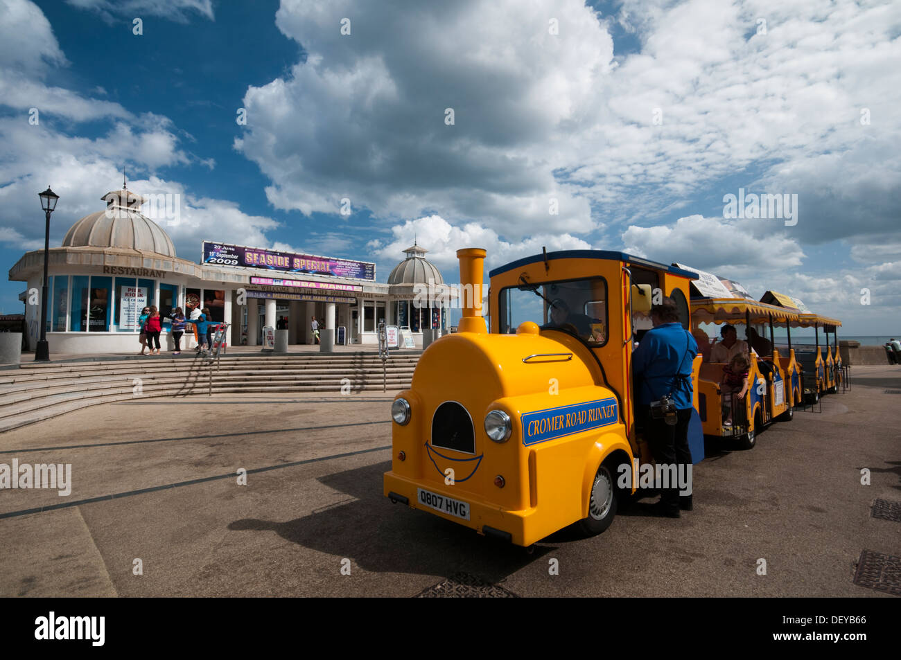 Small train used to take tourists around the town in front of Cromer Pier seaside resort in Norfolk East Anglia England - Stock Image
