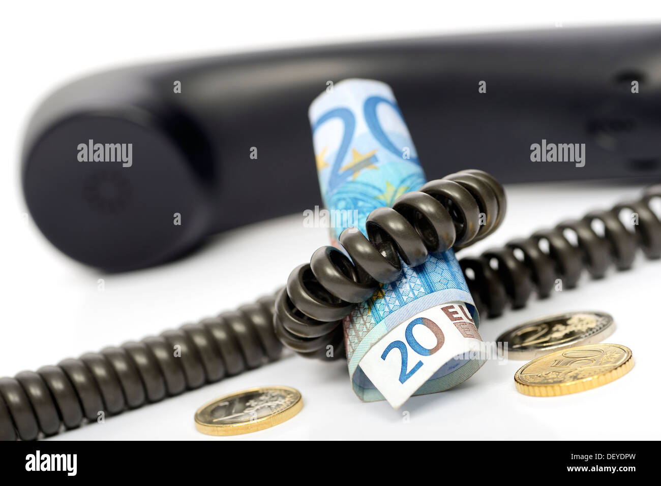 Phone with bank note and monetary coins, symbolic photo waiting loop liable for costs, Telefon mit Geldschein und Stock Photo