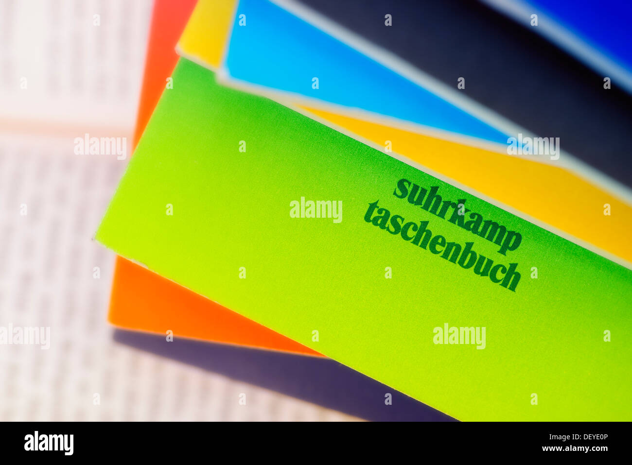 Book pile with Suhrkamp paperback, Bücherstapel mit Suhrkamp Taschenbuch - Stock Image