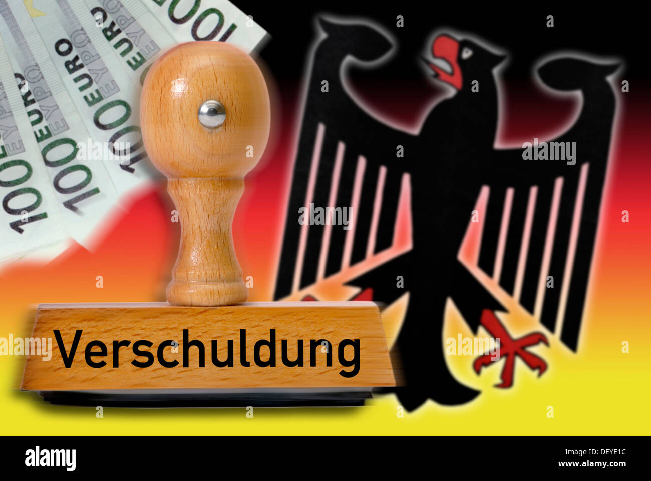 Stamp with the word 'Verschuldung', debt, German eagle and national colors - Stock Image