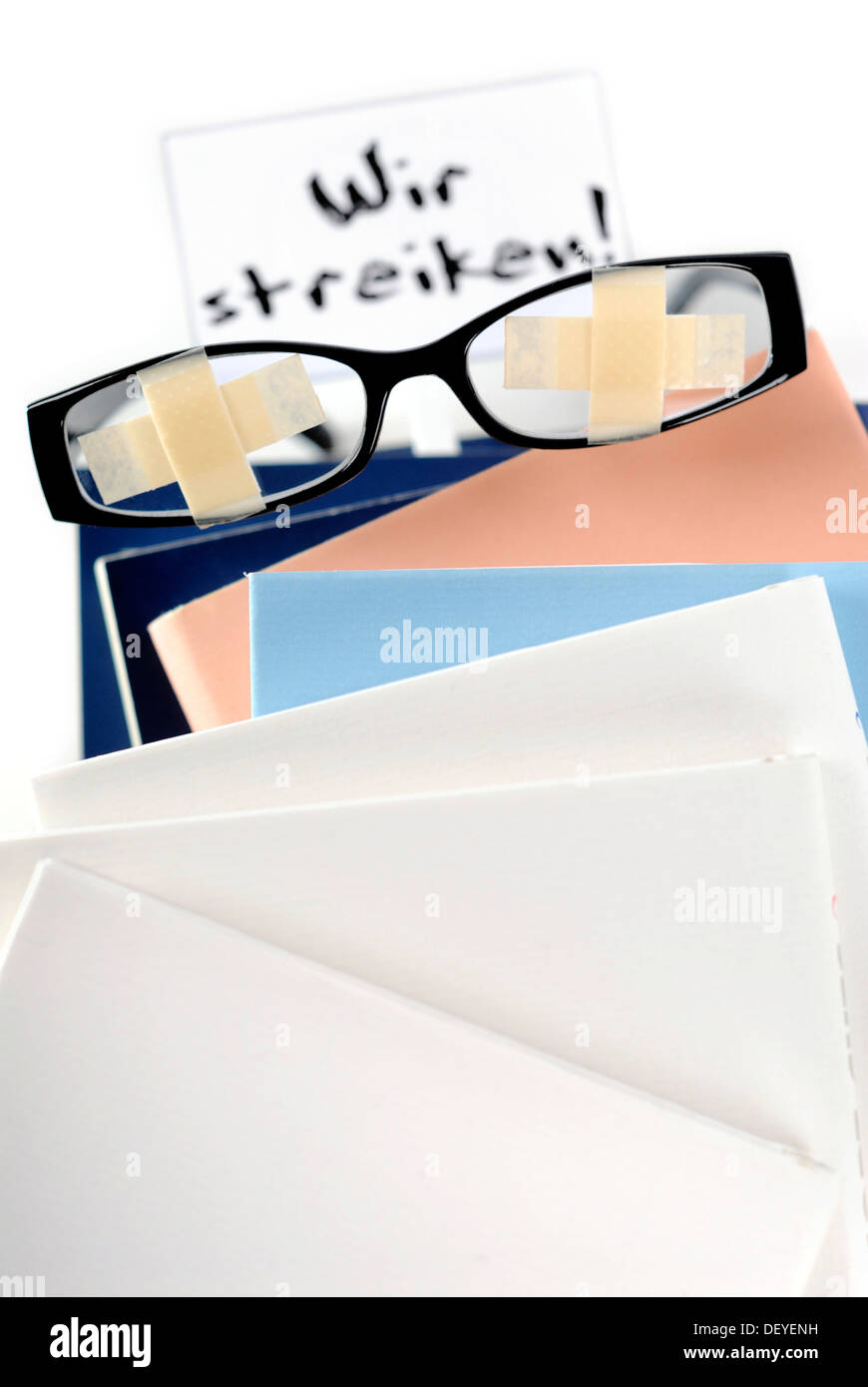 Glasses with plasters on pile of books with a strike sign, symbolic image for students' strike, education problems Stock Photo