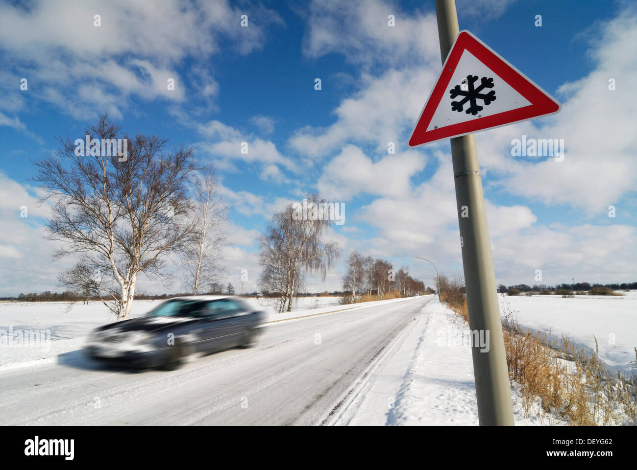 Car on snow-covered roads, slippery roads - Stock Image