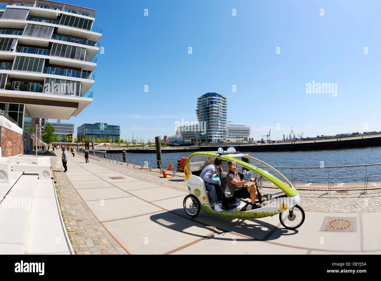 Bicycle taxi on the Dalmannkai Promenade, Hafencity, Hamburg - Stock Image