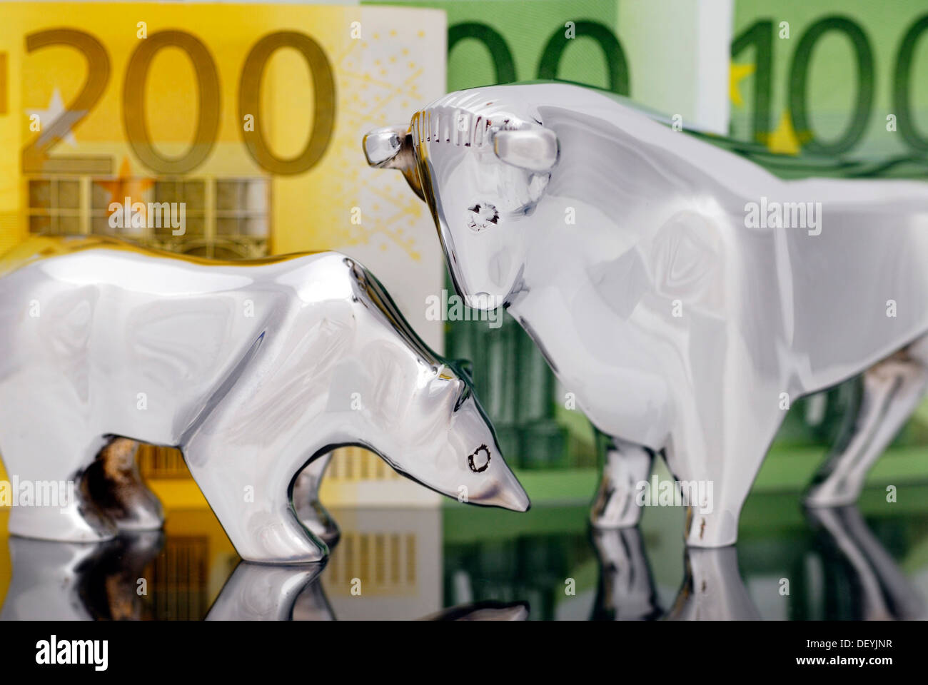 Stock Market Symbols Bull And Bear In Front Of Euro Banknotes Stock