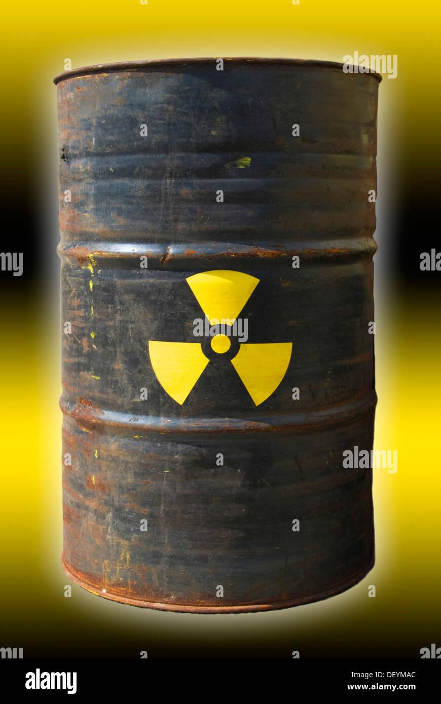 Rusty barrel with a radiation warning symbol - Stock Image