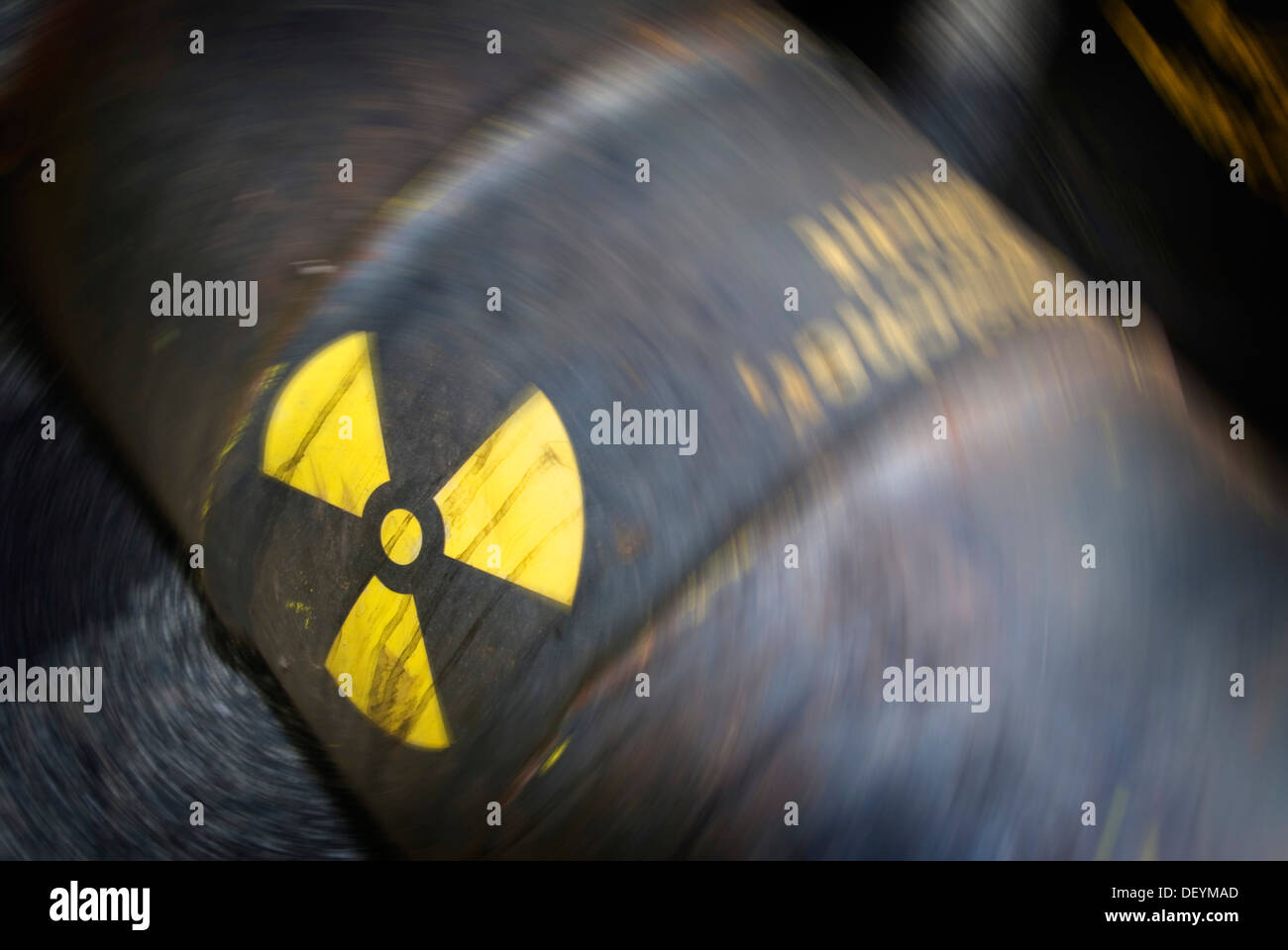 Rusty barrel with a radiation warning symbol Stock Photo