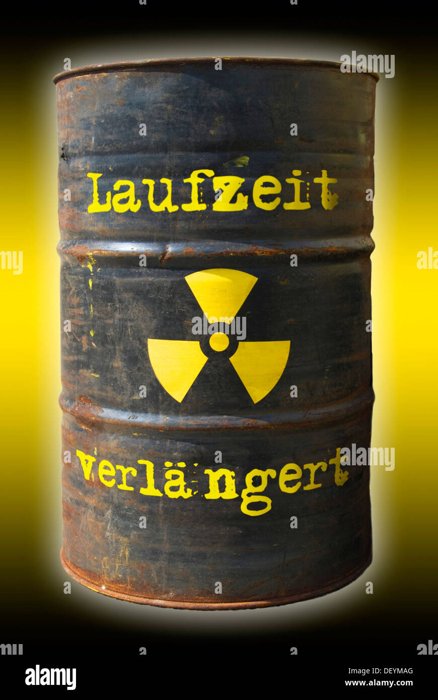 Rusty barrel with a radiation warning symbol and lettering 'Laufzeit verlaengert', German for 'extended runtime' - Stock Image