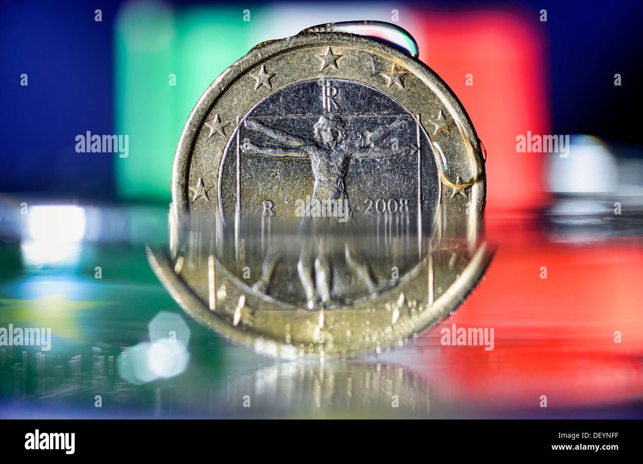 Italian eurocoin of water washed around, debt crisis in Italy, Italienische Euromünze von Wasser umspült, Schuldenkrise Stock Photo