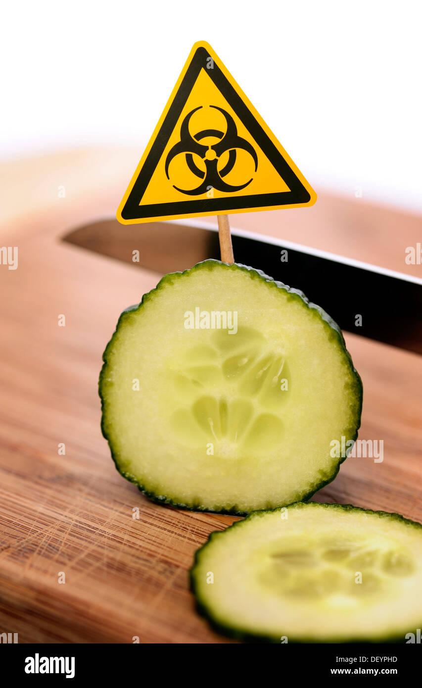 Sliced cucumber with bio-hazard symbol, symbolic image for EHEC pathogens - Stock Image
