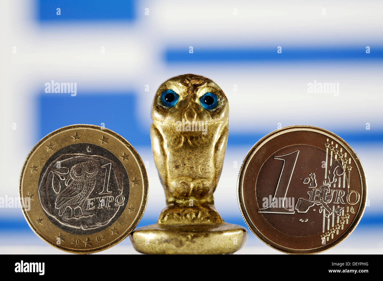 Greek euro, owl and Greek flag, symbolic image for the imminent national bankruptcy of Greece - Stock Image