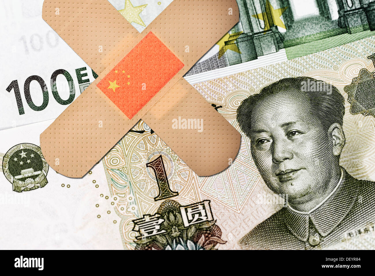 Banknotes, Chinese yuan and a 100 euro note with sticking plasters, symbolic image, China offered help for the euro Stock Photo