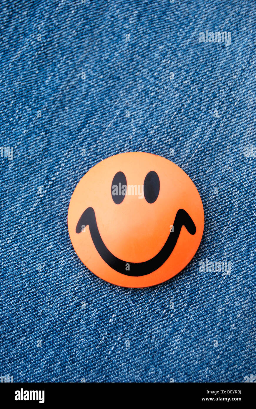 Smiley, kitchen magnets, orange, jeans, good mood - Stock Image