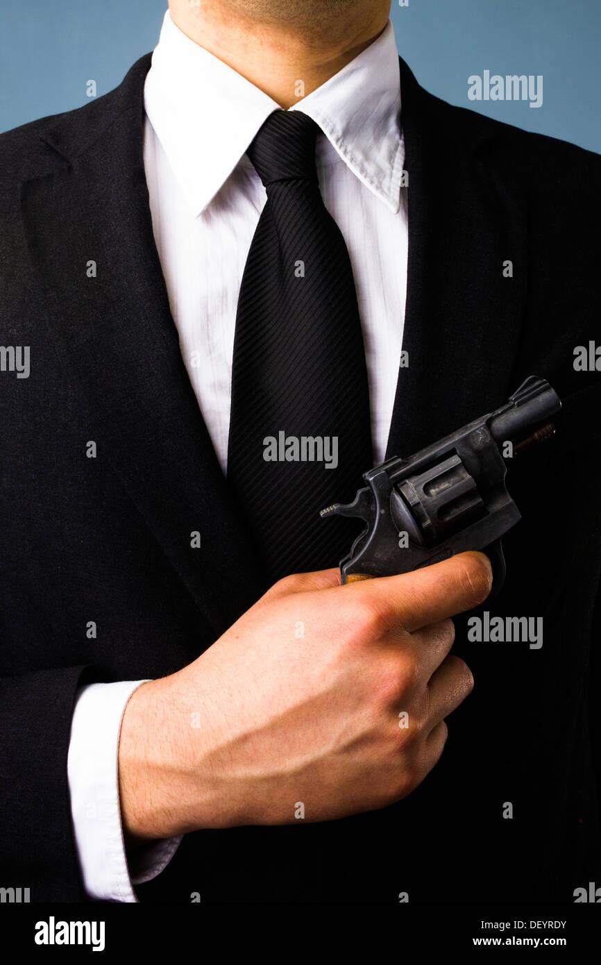 Business man holding a gun - Stock Image