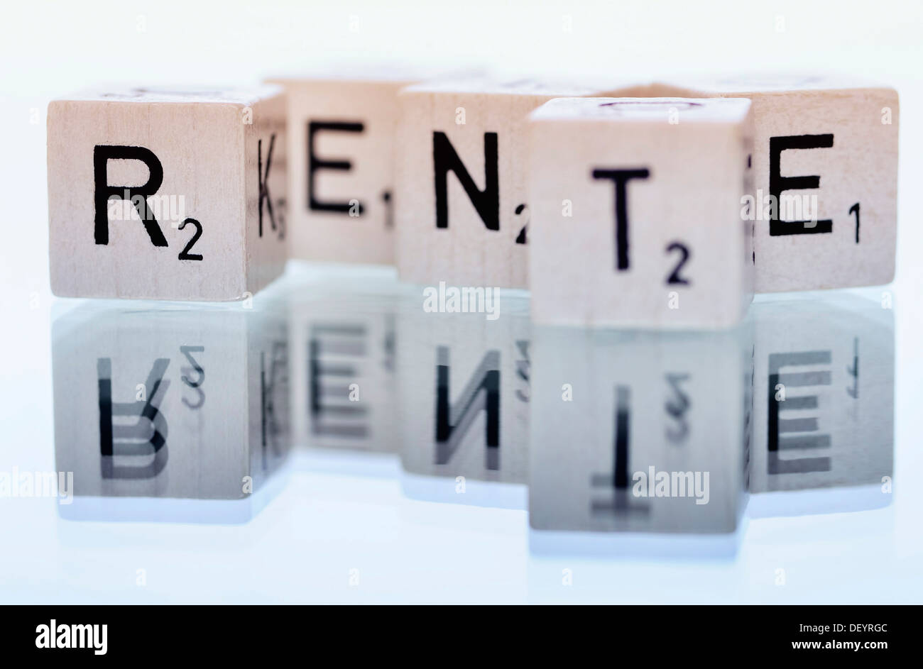 Cubes with letters forming the word 'Rente', German for 'pension' - Stock Image