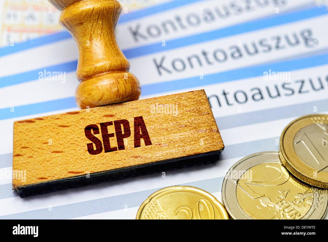 Stamp with SEPA stroke on bank statements, SEPA procedures, Stempel mit SEPA-Schriftzug auf Kontoauszügen, SEPA-Verfahren - Stock Image