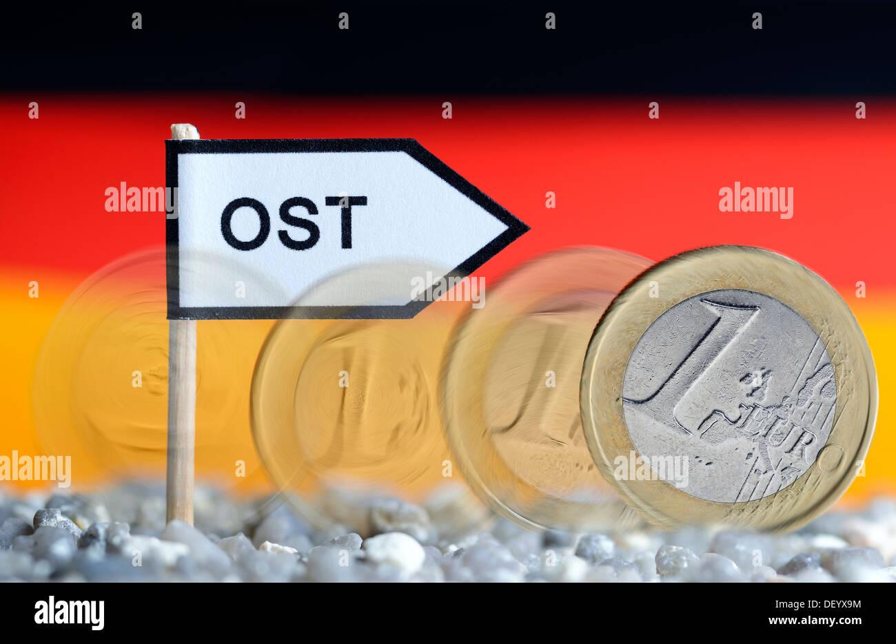 Rolling euro-coin one after the east, retention solidarity tax, Rollende Ein-Euro-Münze nach Ost, Beibehaltung Solidaritätszusch - Stock Image