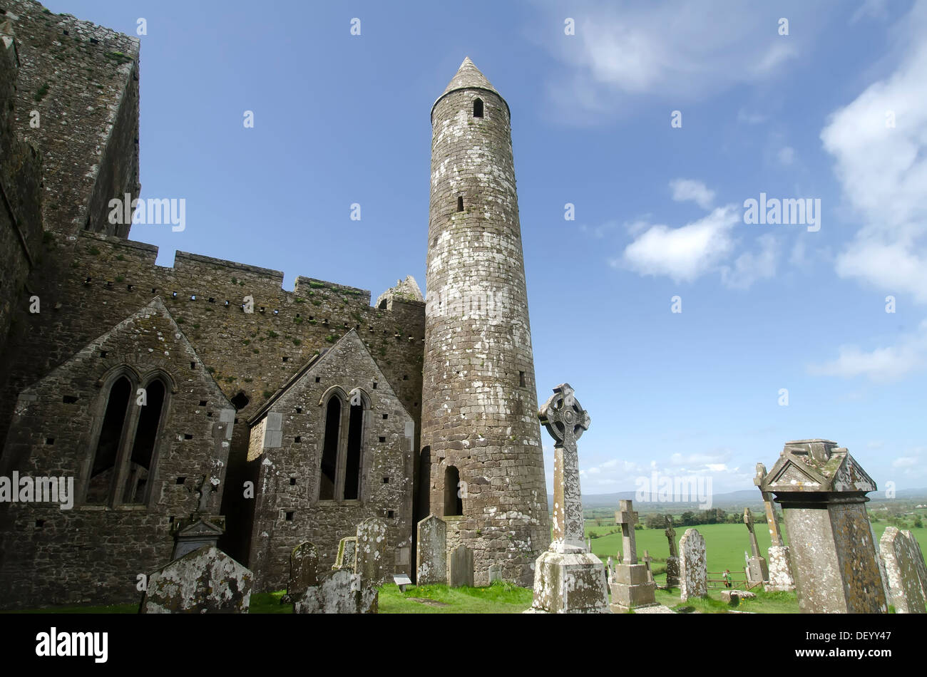 Round stone tower beside Cathedral ruins at St. Patrick's Rock of Cashel, popular medieval attraction Tipperary Co  Ireland - Stock Image