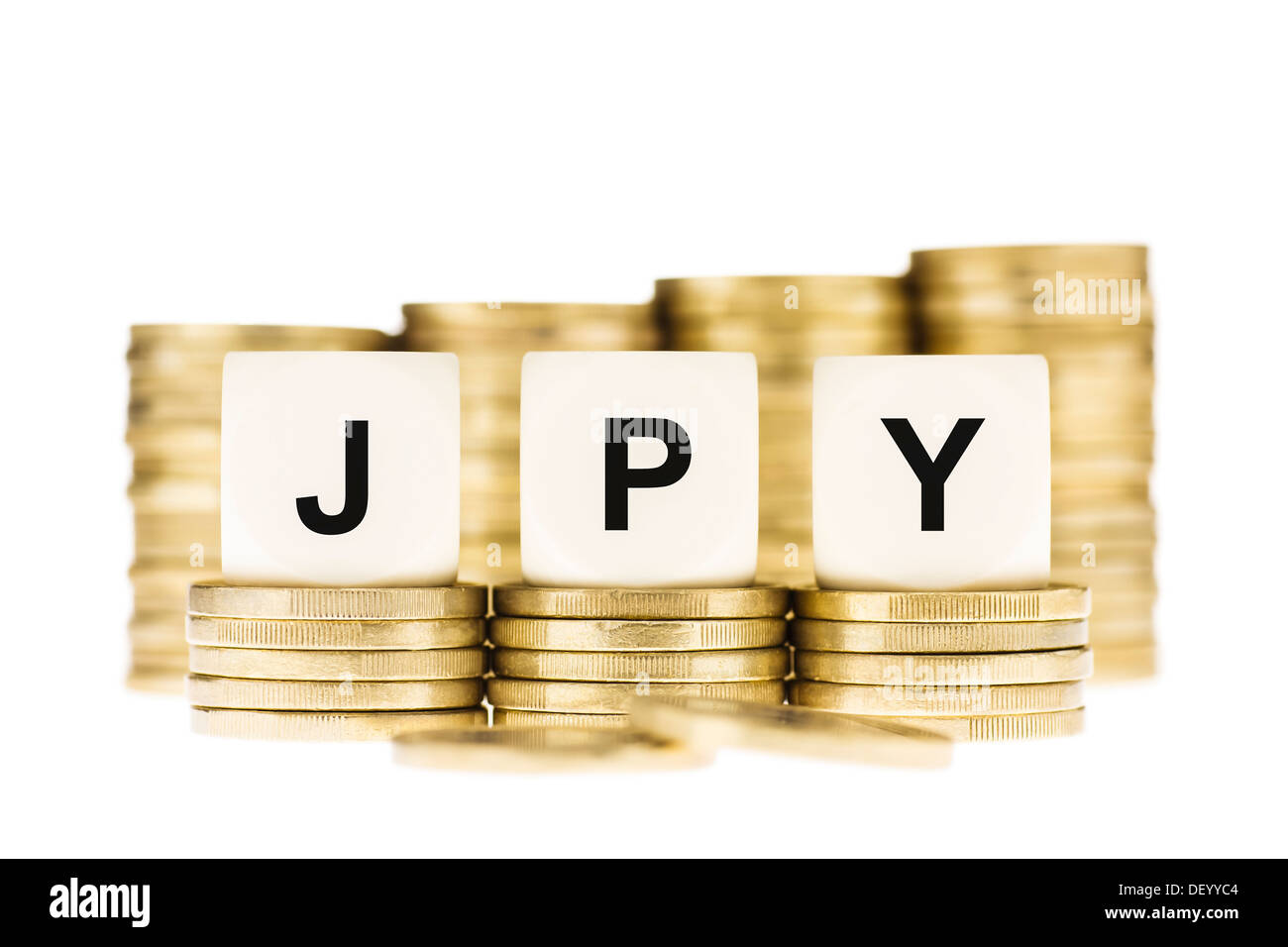 JPY (Japanese Currency) on Gold Coin Stacks Isolated on White - Stock Image