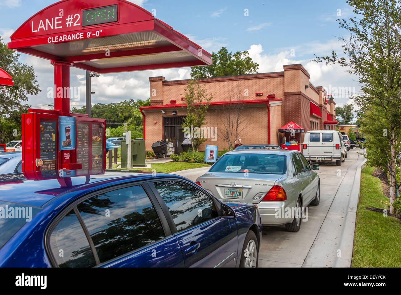 Cars lined up two wide at the Chick-fil-a fast food restaurant in Ocala, Florida in support of Christian values - Stock Image